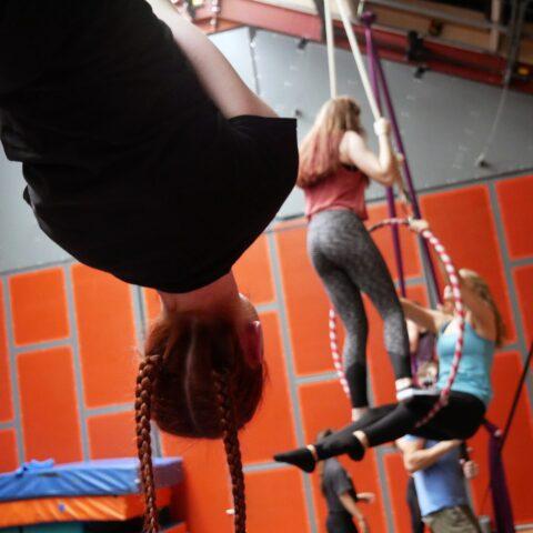 Three girls practising aerial circus tricks