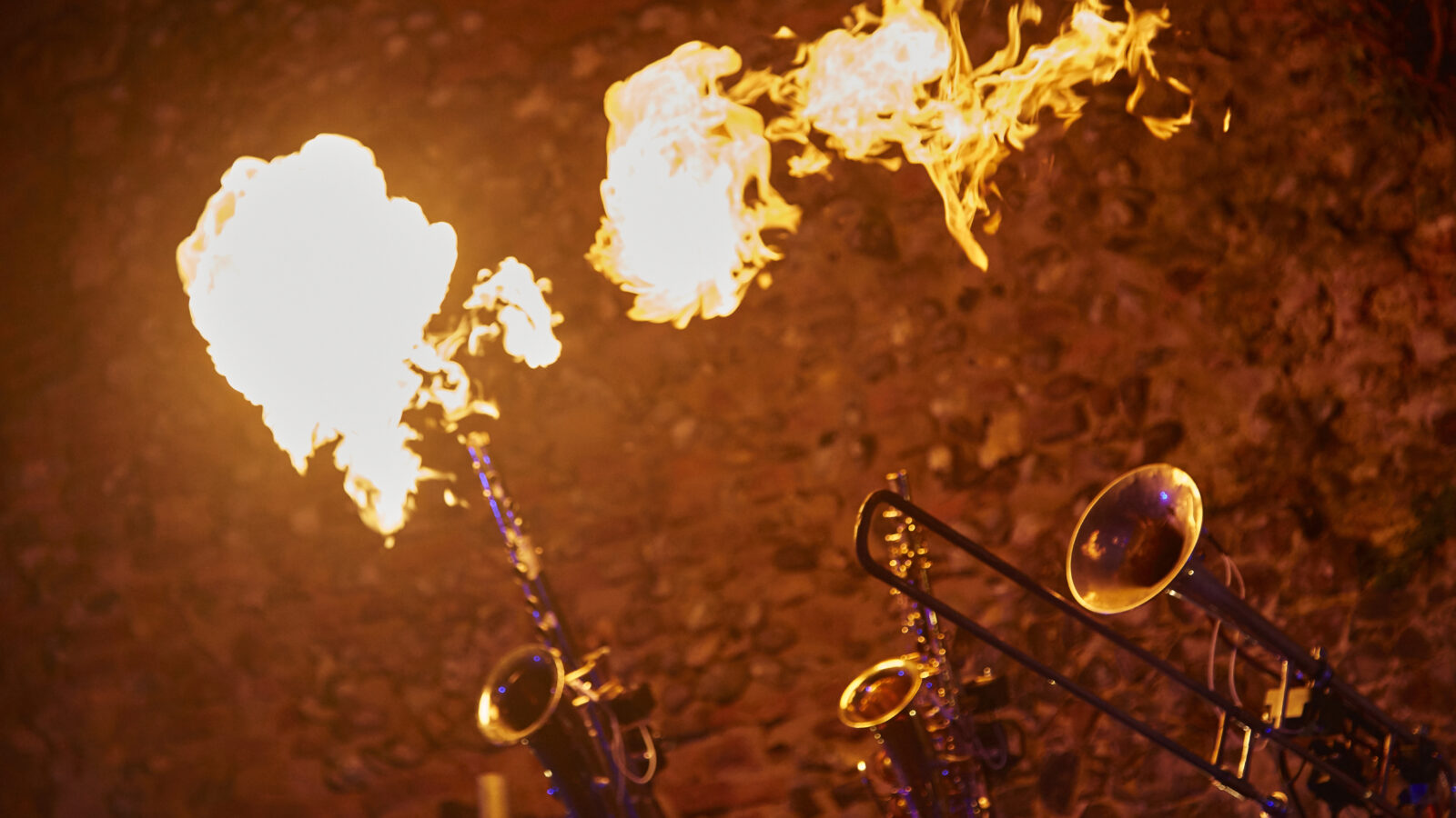 Trumpets blowing fire in musical timings