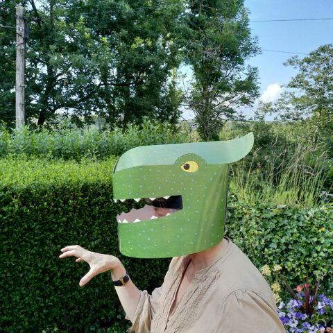 Audience wears paper crafted Godzilla Mask